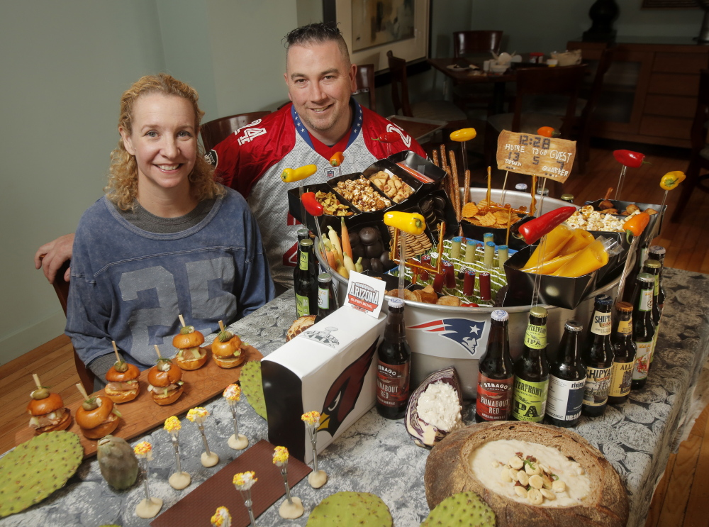 Brian and Shanna O'Hea's snack stadium includes regional items like clam chowder and salmon sliders to represent New England and Seattle, the opposing teams.
