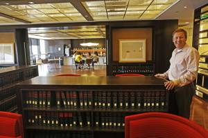 "Managing partner Greg Koltun shows off the ""loungebrary"" at the law firm Morrison & Foerster. The Los Angeles firm scaled back its library to create a communal hang-out space. (Los Angeles Times/Anne Cusack)"