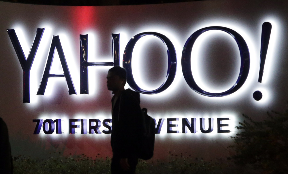 A pedestrian is silhouetted against a sign at Yahoo's headquarters in Sunnyvale, Calif.