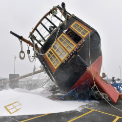 Newport, R.I., took the full brunt of the blizzard, which toppled the tall ship replica of the USS Providence on the dock, breaking the mast and puncturing the hull.