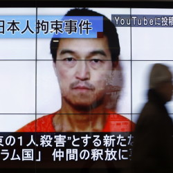 A news screen in Tokyo displays an image of Kenji Goto, a Japanese journalist captured by Islamic State militants. Indirect talks through religious and tribal leaders in Iraq are under way to free the hostages.