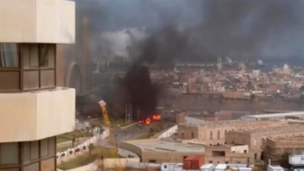 In this image made from video posted by a Libyan blogger, the Corinthia Hotel in Tripoli, Libya, is seen under attack Tuesday. Gunmen stormed the luxury hotel, killing several foreigners and guards, officials said.