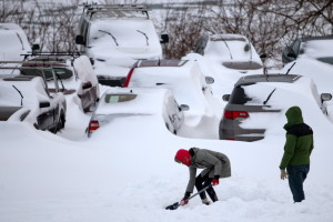 Portlanders dig their cars out at the Eastern Prom on Wednesday. During winter storms, city officials urge residents to keep their vehicles off snow-clogged streets.