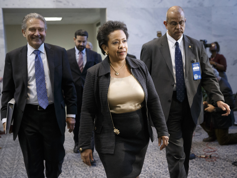 In this Dec. 2, 2014 file photo, Attorney General nominee Loretta Lynch arrives for a meeting with fellow New Yorker, Sen. Charles Schumer, D-N.Y., on Capitol Hill in Washington.