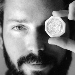 Tommy Thompson holds a $50 pioneer gold piece retrieved earlier in 1989 from the wreck of the gold ship SS Central America. Thompson, a fugitive treasure hunter wanted for more than two years, was arrested in Florida.