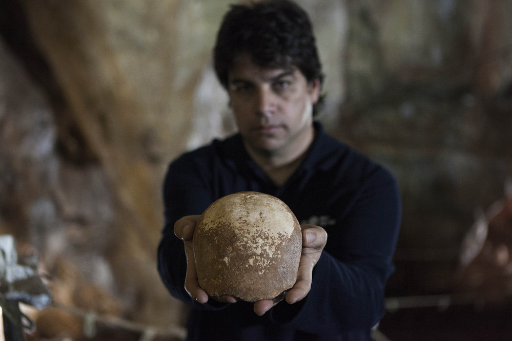 Dr. Omry Barzilai of Israel's Antiquities Authority holds an ancient skull found in a cave near the northern city of Nahariya. The skull dates from around 55,000 years ago.