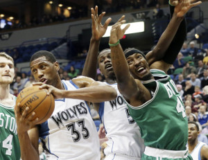 The Minnesota Timberwolves' Thaddeus Young, left, beats the Celtics' Gerald Wallace, right, to the rebound in the first quarter of Wednesday night's game in Minneapolis. Young had 12 points and nine rebounds in the game.
