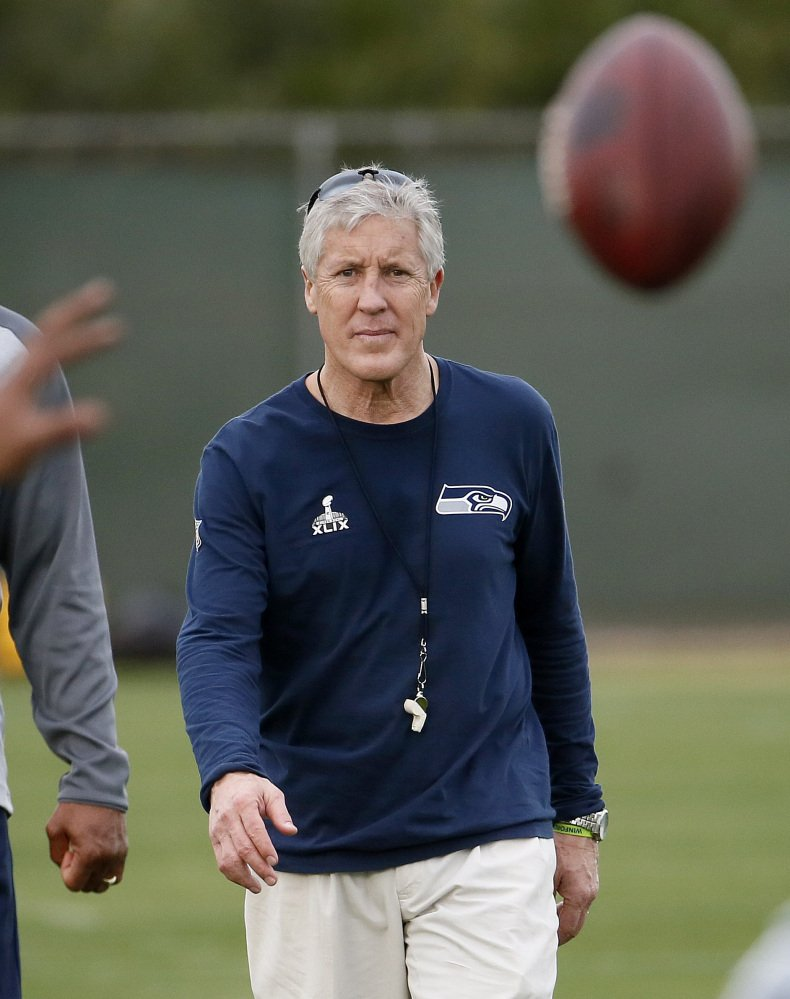 "Pete Carroll, coach of the Seattle Seahawks, watches his team run drills Wednesday in Tempe, Ariz. New England Patriots Coach Bill Belichick said there's ""not a coach in the NFL I respect more than Pete Carroll."""