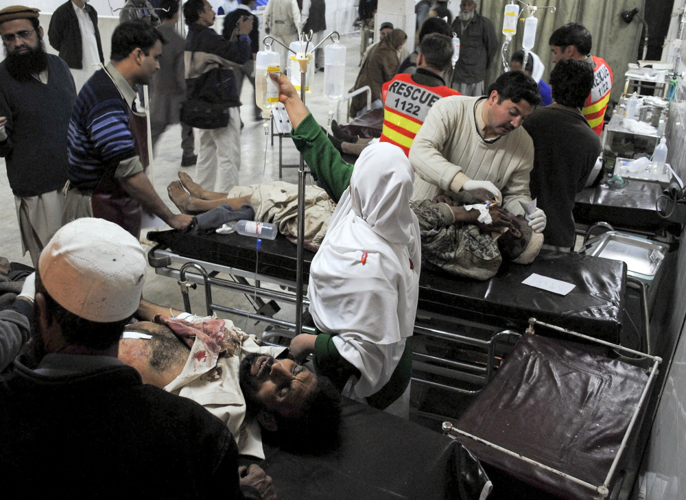 Wounded victims of a suicide bombing are treated at a hospital in Peshawar, Pakistan, in 2010 after a female suicide bomber detonated an explosives-laden vest in a crowded aid distribution center. Terrorist groups have been recruiting women for years, but authorities underestimate them, counterterrorism experts say.