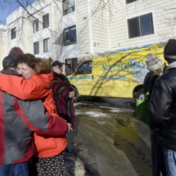 Ellen Schlehuber gets a hug from fellow tenant Jeff Buotte as residents are allowed to retrieve personal items Thursday after an early morning fire at Centennial Place apartments in Old Orchard Beach. The fire, which was blamed on a cooking accident, displaced two dozen elderly and disabled people.