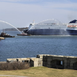 The Nova Scotia government will announce its plans next week for the future of the Nova Star ferry, shown here in Portland harbor passing Spring Point Light in South Portland while a tugboat sprays a welcome.