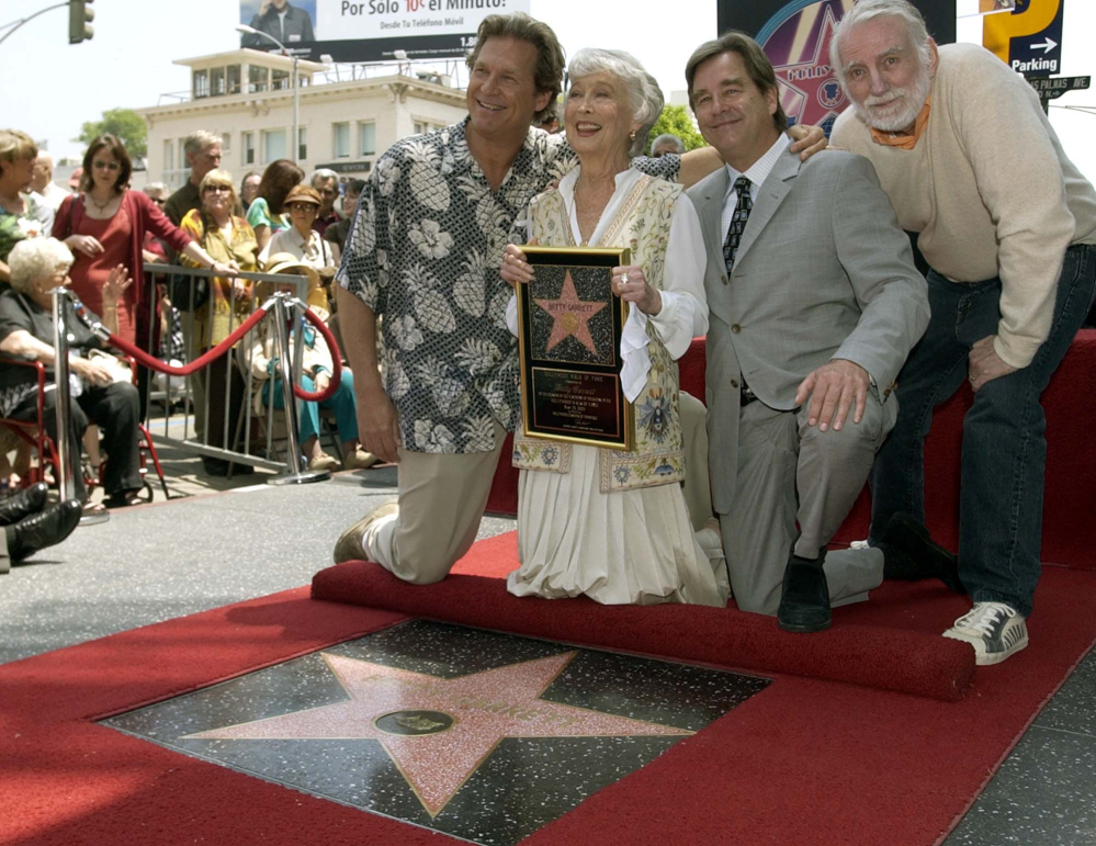 2003 Associated Press File Photo Actress Betty Garrett holds a replica of her new star as she poses with Jeff Bridges, left, Beau Bridges, center, and Rod McKuen, right, after her star was unveiled on the Hollywood Walk of Fame in Los Angeles. McKuen died Thursday. He was 81.