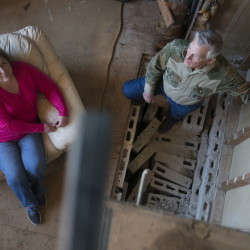 Sandra Ladra and her husband, Gary, stand where their 28-foot-tall stone fireplace used to be. An intraplate earthquake in Prague, Okla., measuring a record 5.6 caused it to crumble on Nov. 5, 2011. Washington Post photo by Linda Davidson