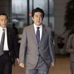 Japan's Prime Minister Shinzo Abe, center, arrives at his residence in Tokyo on Friday, after a possible prisoner swap wasn't carried out by Thursday.