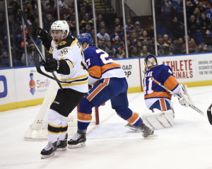 Boston Bruins right wing Reilly Smith celebrates his goal as Islanders goalie Jaroslav Halak looks toward the net during the first period of Thursday night's game at the Nassau Coliseum in Uniondale, N.Y. The Bruins handed the Islanders just their fifth loss this season on home ice.