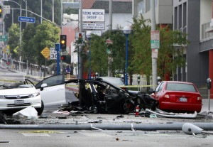 A street is closed after a car crash in West Hollywood, Calif., on July 4. The chances of dying in a crash in a late-model car or light truck fell by more than a third over three years.