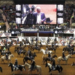Riders come into the Fort Worth Stock Show & Rodeo on Friday for the Grand Entry. The event has long featured a Christian flavor, but this year a Muslim imam led prayers.