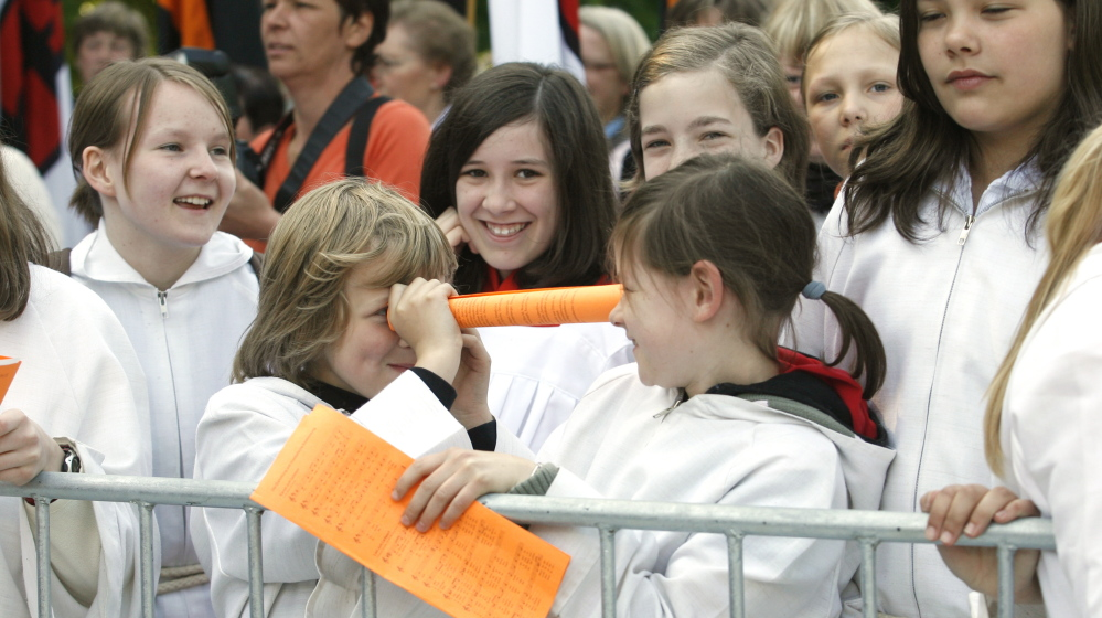 Altar girls joke with each other as they wait for a Mass at the 97th German Catholic Conference in Osnabrueck in 2008. The priest at a Roman Catholic church in San Francisco has prohibited girls from becoming altar servers.