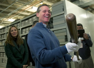 Craig Biggio, who was elected this month to the Hall of Fame, holds Babe Ruth's bat in the collections area Friday during his orientation visit to Cooperstown, N.Y.