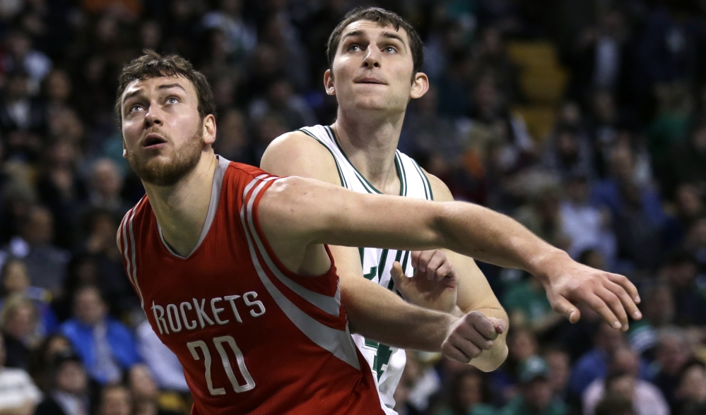Houston Rockets forward Donatas Motiejunas blocks out Celtics center Tyler Zeller on a rebound during the second quarter of Friday night's game in Boston. Motiejunas had 26 points in the Rockets' 93-87 win.