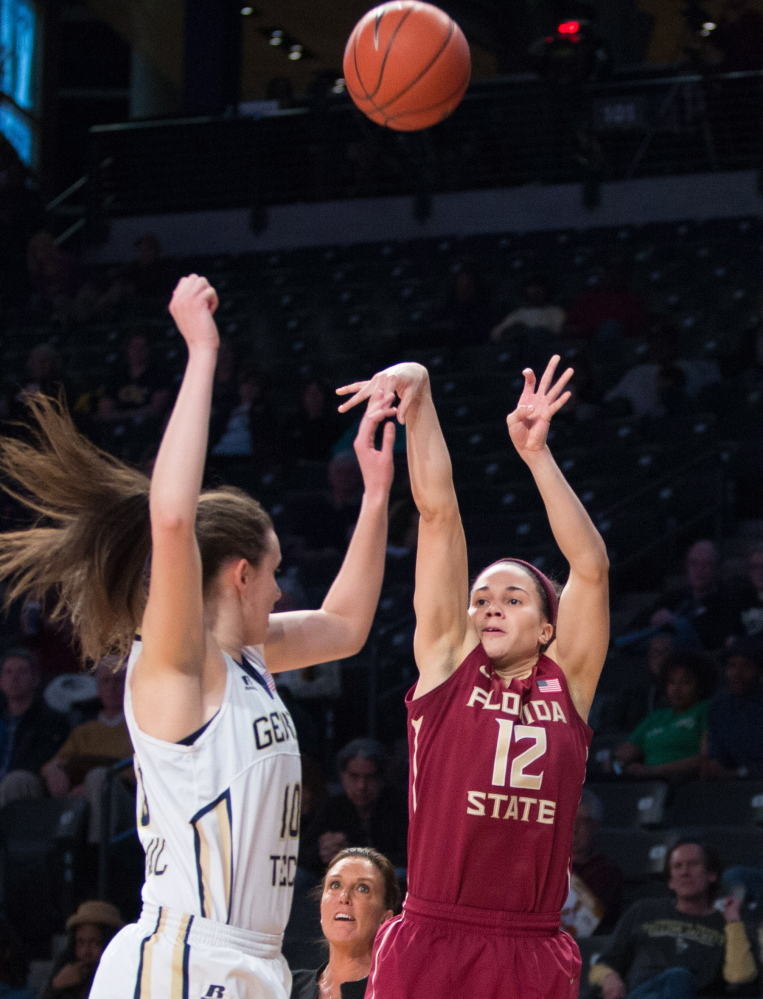 Brittany Brown of Florida State shoots a 3-pointer over Georgia Tech's Katarina Vuckovic during the first half of their Atlantic Coast Conference game Friday in Atlanta. Ninth-ranked Florida State won, 82-62.