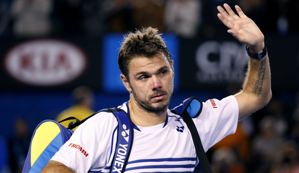 Stan Wawrinka leaves Rod Laver Arena after failing to defend his 2014 Australian Open title. Wawrinka lost in a semifinal match against Novak Djokovic, who advanced to the finals for the fifth time and will face Andy Murray.