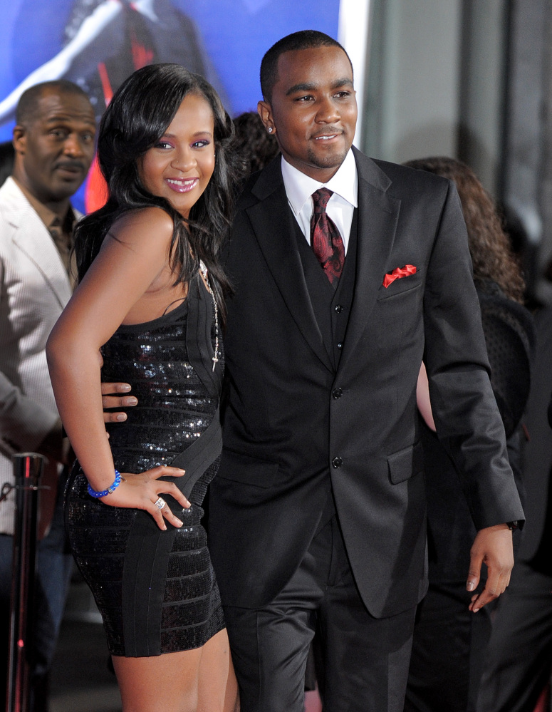 "In this August 2012 photo, Bobbi Kristina Brown, right, and Nick Gordon attend the Los Angeles premiere of ""Sparkle"" at Grauman's Chinese Theatre in Los Angeles. The daughter of late singer and entertainer Whitney Houston was found Saturday unresponsive in a bathtub by her husband and a friend."