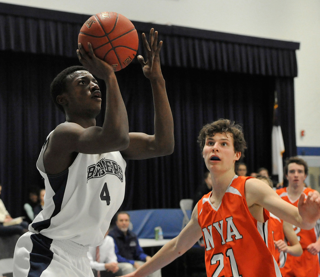 Pine Tree Academy's JP Tshamala shoots the ball in front of NYA's Jake Malcom during the Panthers' win.