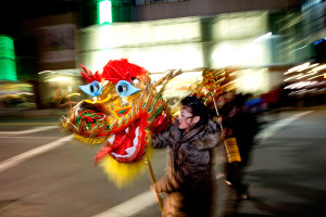 JAN. 2, 2015: Anna Foo, 14, of Cumberland, carries the head of a Chinese Dragon as she and other students, ages 12-15, from the Chinese & American Friendship Association of Maine Chinese School promoted their celebration of the Chinese New Year.