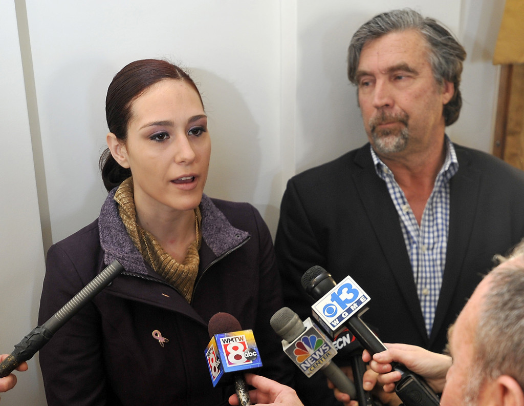 Ashley Summers, whose husband died in the Noyes Street fire, and her attorney, Tom Hallett, discuss the status of their lawsuit after a press conference Wednesday in Portland to announce the fire's cause.  Gordon Chibroski / Staff Photographer)