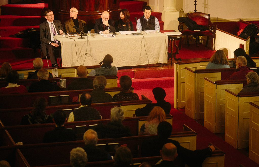Panelists answer questions during Wednesday's forum on immigration at the First Parish Church in Portland.