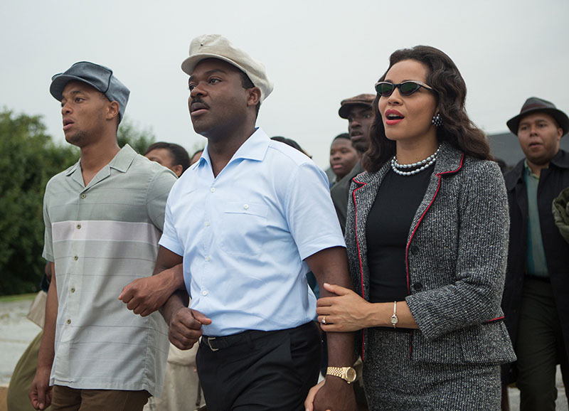 David Oyelowo, center, as Martin Luther King, Jr. and Carmen Ejogo, right, as Coretta Scott King on the march in Selma.