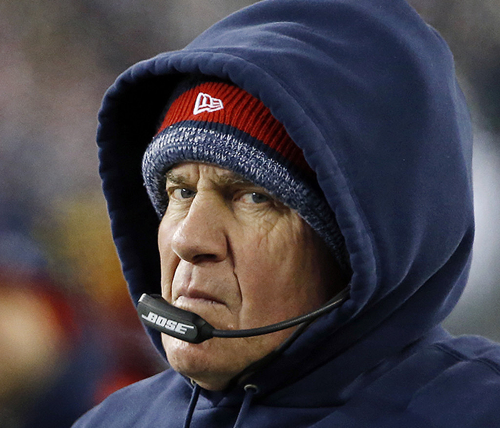 New England Patriots head coach Bill Belichick watches from the sidelines in the first half of an NFL divisional playoff football game against the Baltimore Ravens, Saturday, Jan. 10, 2015, in Foxborough, Mass. The Associated Press