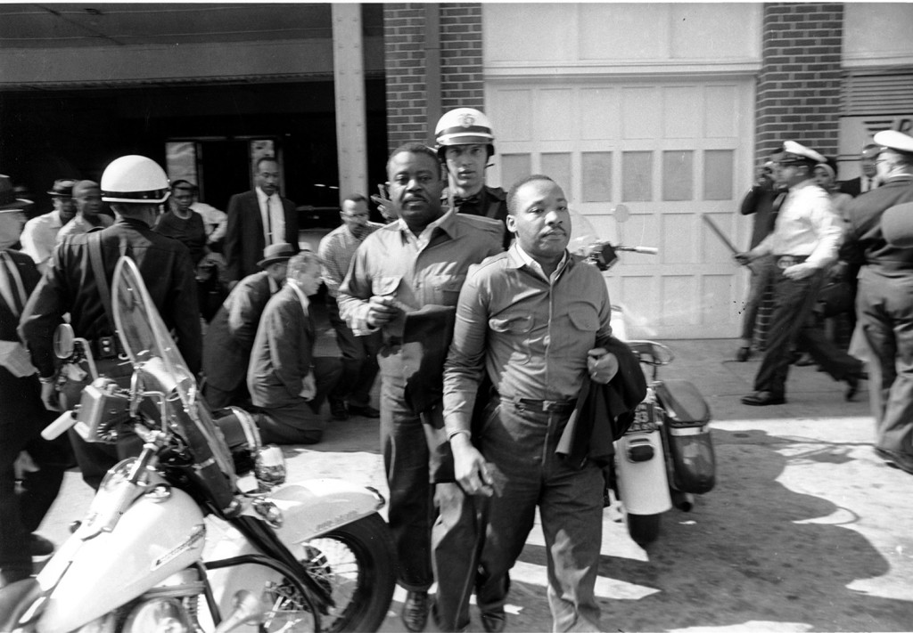 The Rev. Ralph Abernathy, left, and Rev. Martin Luther King Jr., right, are taken by a policeman as they led a line of demonstrators into the business section of Birmingham, Alabama, on April 12, 1963.