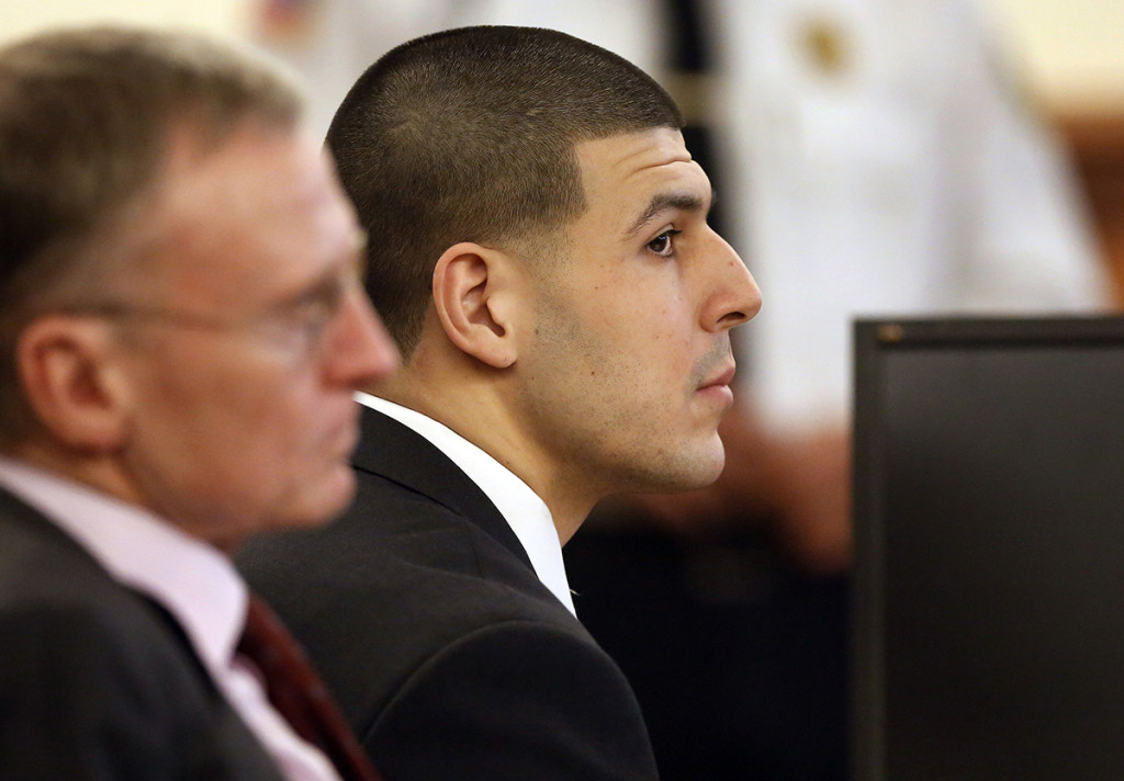 Former New England Patriots football player Aaron Hernandez listens during his murder trial as defense attorney Charles Rankin, left, looks on, Thursday in Fall River, Mass. Hernandez is charged with killing semiprofessional football player Odin Lloyd, 27, in June 2013. The Associated Press