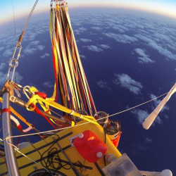 In this photo provided by the Two Eagles Balloon Team, Troy Bradley of New Mexico and Leonid Tiukhtyaev of Russia set off from Saga, Japan, shortly before 6:30 a.m. Sunday in their quest to pilot their helium-filled balloon from Japan  to North America and break two major records en route. The Associated Press
