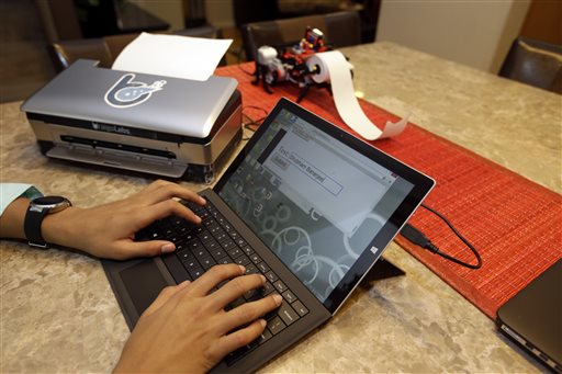 Shubham Banerjee works on a Braigo 2.0 Braille printer prototype. The eighth-grader is believed to be the youngest entrepreneur to receive venture capital funding. The Associated Press