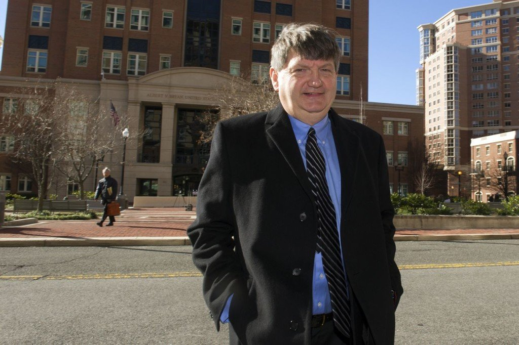 """New York Times reporter James Risen leaves federal court in Alexandria, Va., in this Jan. 5, 2015, photo. Risen's 2006 book, """"State of War,"""" describes the secret CIA mission to derail Iran's nuclear ambitions by giving them deliberately flawed blueprints as hopelessly botched. The Associated Press"""
