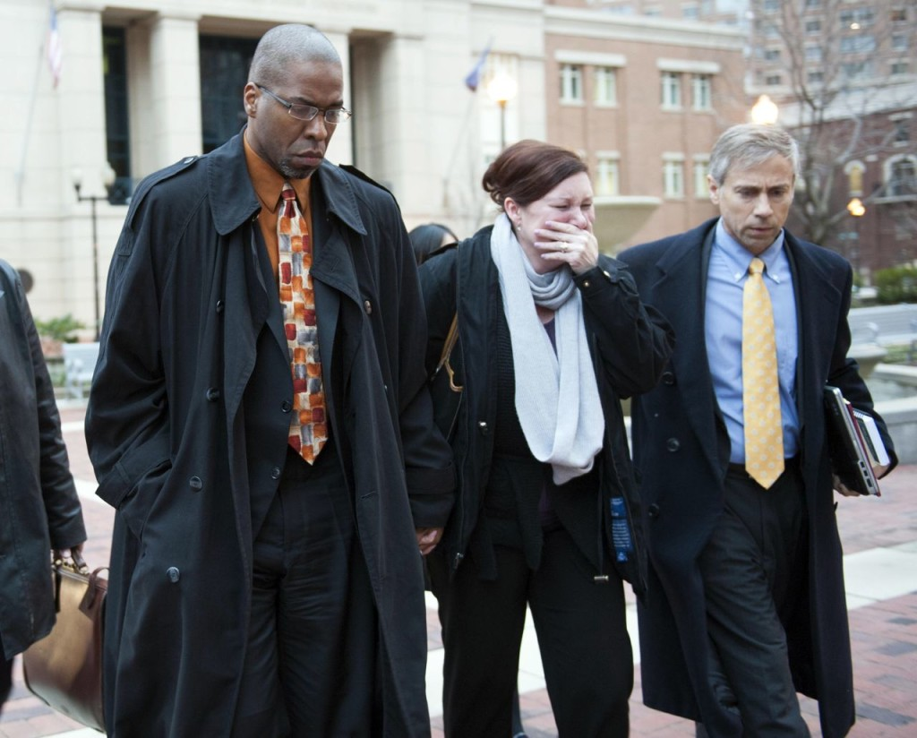 Former CIA officer Jeffrey Sterling, left, leaves the Alexandria Federal Courthouse Monday in Alexandria, Va., with his wife, Holly, and attorney Barry Pollack, after being convicted on all nine counts he faced of leaking classified details of an operation to thwart Iran's nuclear ambitions to a New York Times reporter. The Associated Press