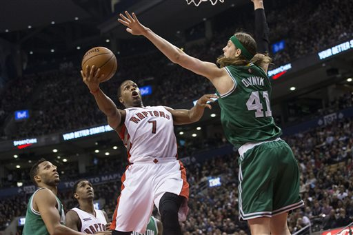 Toronto Raptors' Kyle Lowry scores on Boston Celtics' Kelly Olynyk during the second half Saturday in Toronto. The Associated Press