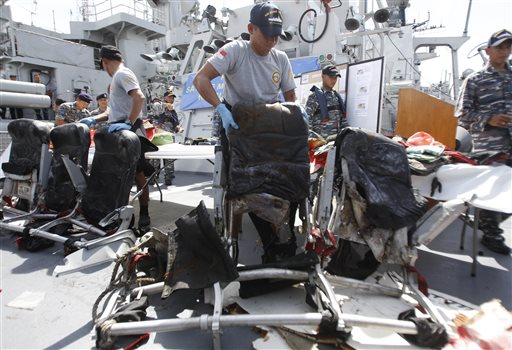 Crew members of Indonesian navy ship KRI Bung Tomo show airplane seats from AirAsia Flight 8501 recovered in search operations for the ill-fated jetliner, during a news conference Monday at the navy's Eastern Fleet Naval Base in Surabaya, East Java, Indonesia. The Associated Press
