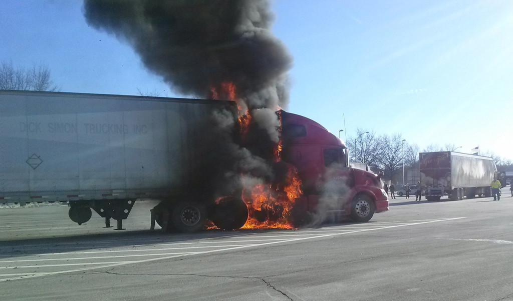 A tractor-trailer truck burns at the Kennebunk southbound service plaza on the Maine Turnpike on Friday.