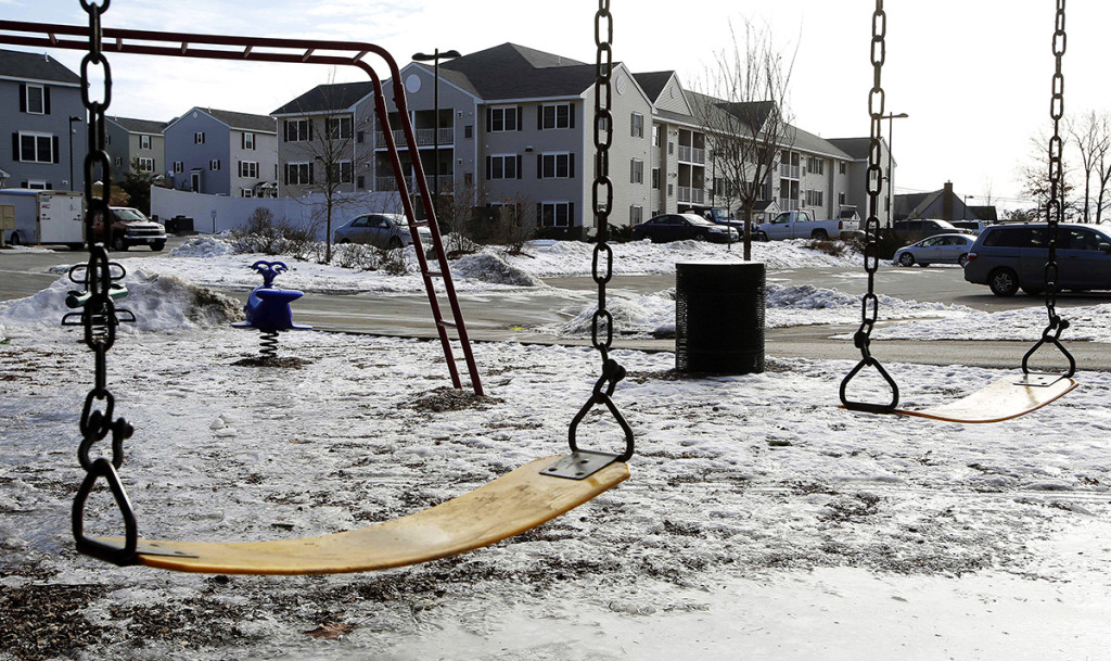 An empty playground is seen at an apartment complex Thursday in Manchester, N.H., where authorities say twin 9-year-old boys were left mostly alone for four months after their parents took three siblings to Nigeria and left an uncle to care for them. The Associated Press