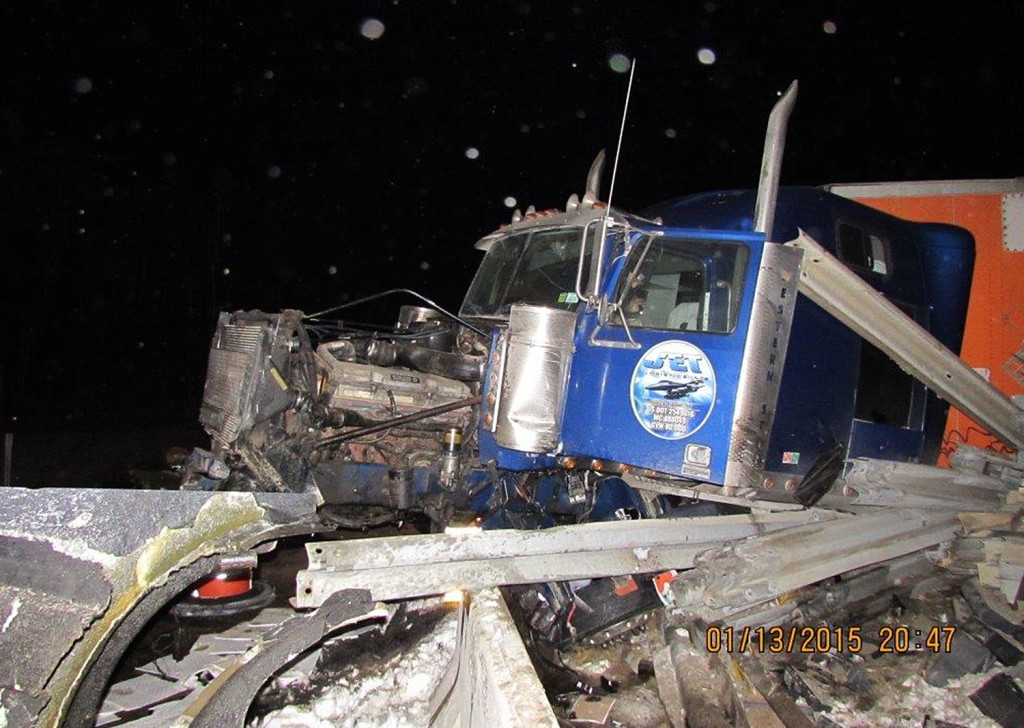 This tractor-trailer wreck closed Exit 80 on the Maine Turnpike in Lewiston Tuesday night. The wreckage was removed before Wednesday morning's commute, but crews were expected to close the exit for more repairs Wednesday afternoon. Photo courtesy Maine Department of Public Safety