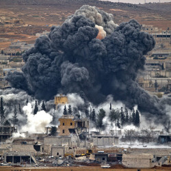 Smoke rises from the Syrian city of Kobani after an airstrike by the U.S.-led coalition in November. Kurdish fighters ousted Islamic State militants from the key border town on Monday.