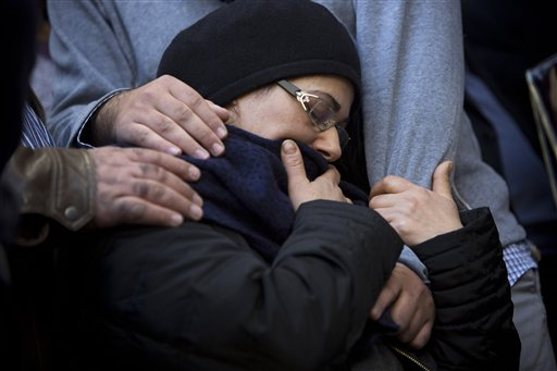 The mother of French Jew Yoav Hattab, a victim of the attack on a kosher grocery store in Paris, is comforted during his funeral procession in the city of Bnei Brak near Tel Aviv, Israel, Tuesday. The Associated Press
