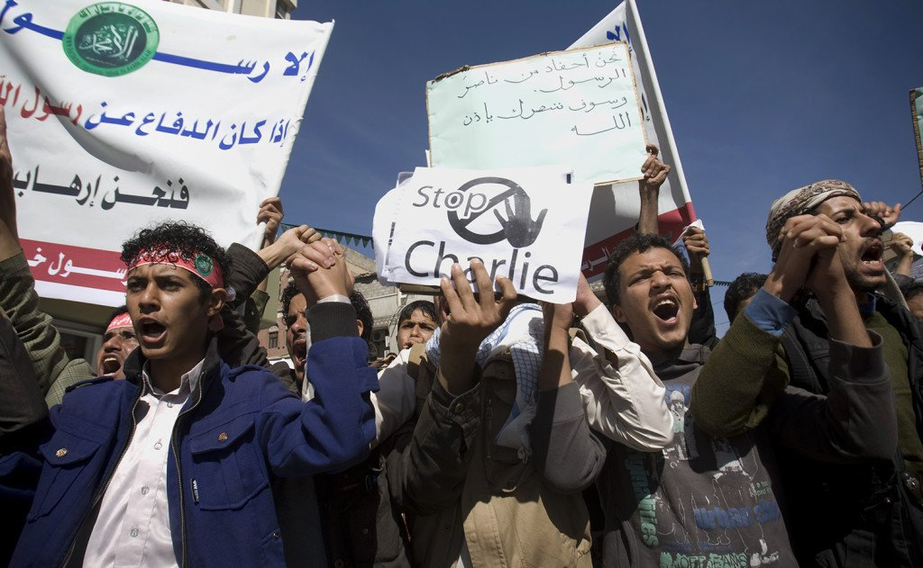 Yemenis chant slogans during a protest against caricatures published in French magazine Charlie Hebdo in front of the French Embassy in Sanaa, Yemen, Saturday. The Associated Press