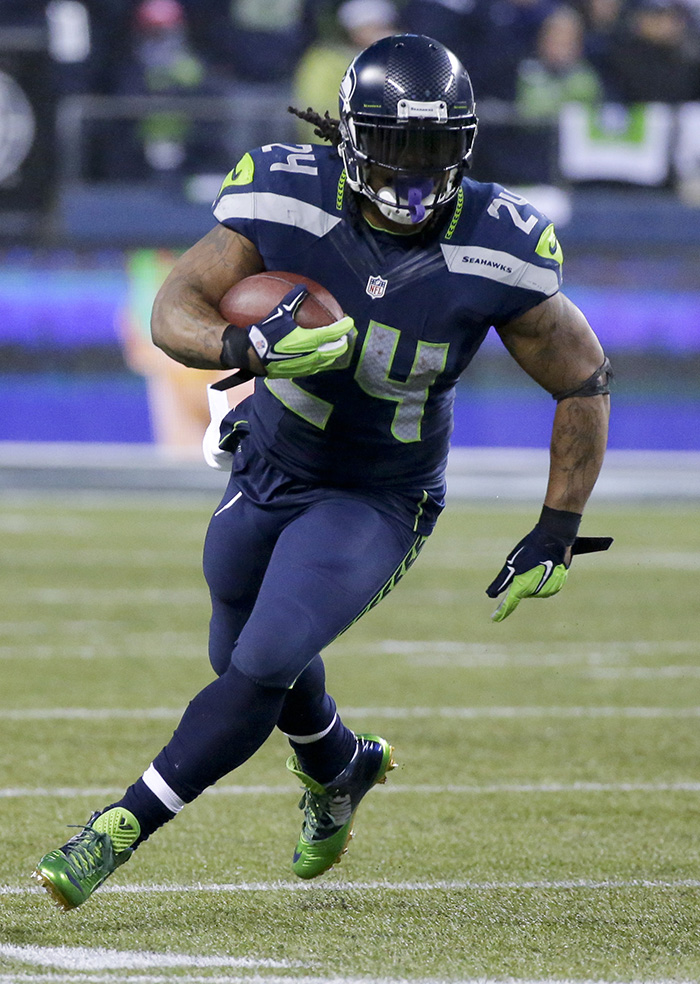 Seattle Seahawks running back Marshawn Lynch runs against the Carolina Panthers during the second half of their divisional playoff game in Seattle on Jan. 10. Lynch will be a threat both to run and catch the ball when the Patriots meet the Seahawks in the Super Bowl on Feb. 1. The Associated Press