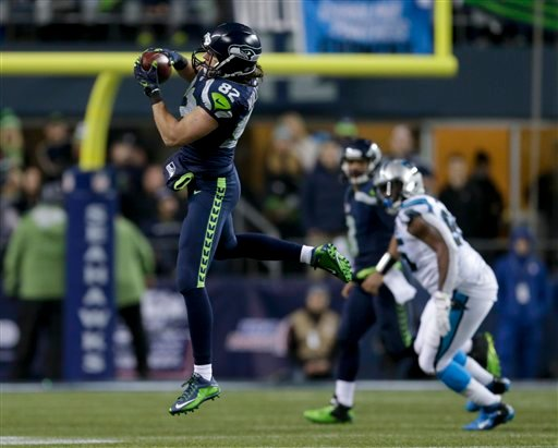 Seattle Seahawks tight end Luke Willson catches a pass against the Carolina Panthers in the second half in Seattle on Saturday. The Associated Press