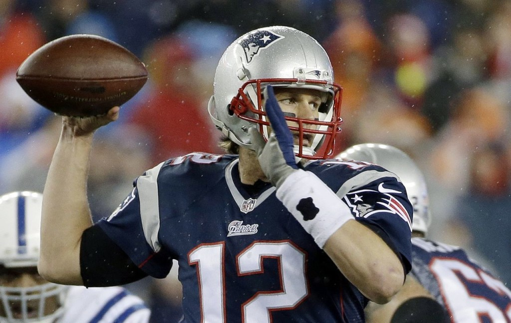 """New England Patriots quarterback Tom Brady looks to pass during the first half of Sunday's AFC Championship game against the Indianapolis Colts in Foxborough, Mass. On his regular weekly morning-after-game appearance Monday on WEEI radio, Brady said the accusation of using underinflated balls was """"ridiculous."""" The Associated Press"""